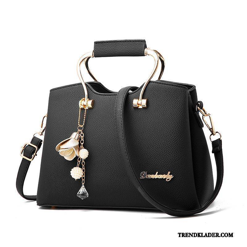 svart handväska dam